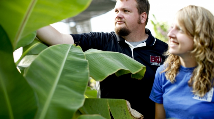 Horticulture manager and student in the greenhouse