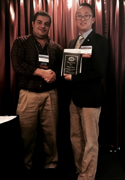 Dr. Zhang (right) accepts the ASC Regional Teaching Award