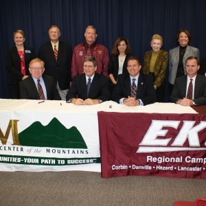 Institution leaders prepare to sign agreement