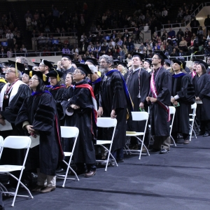 Photo of faculty and students at graduation