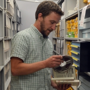Student researching in the library vaults