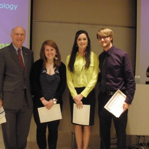 Winning Capstone team with Dean Rogow (left)